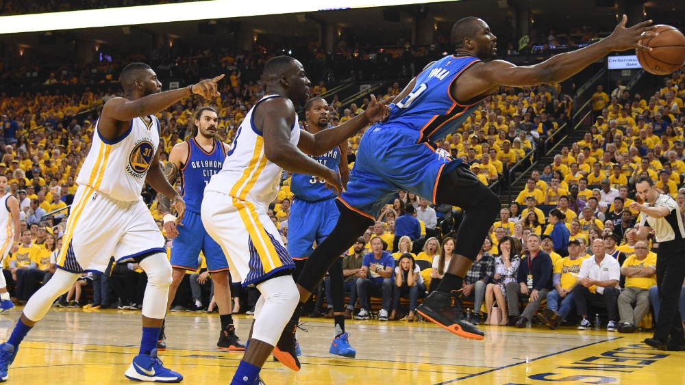 May 18, 2016; Oakland, CA, USA; Oklahoma City Thunder forward Serge Ibaka (9) reaches for a loose ball against Golden State Warriors forward Draymond Green (23) during the second quarter in game two of the Western conference finals of the NBA Playoffs at Oracle Arena. Mandatory Credit: Kyle Terada-USA TODAY Sports